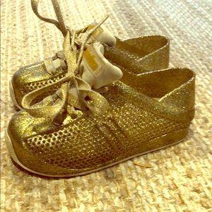 Mini Melissa gold sneakers